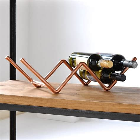 wood and copper wine rack